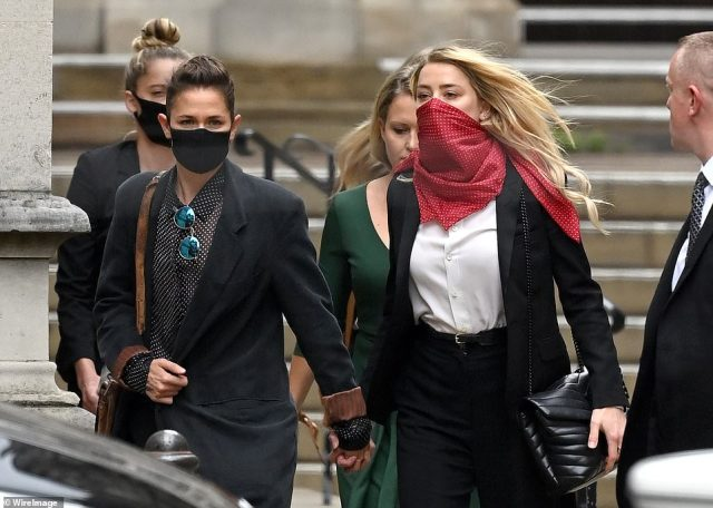 Bianca Butti and Amber Heard depart after attending the libel case between Johnny Depp and The Sun Newspaper in London