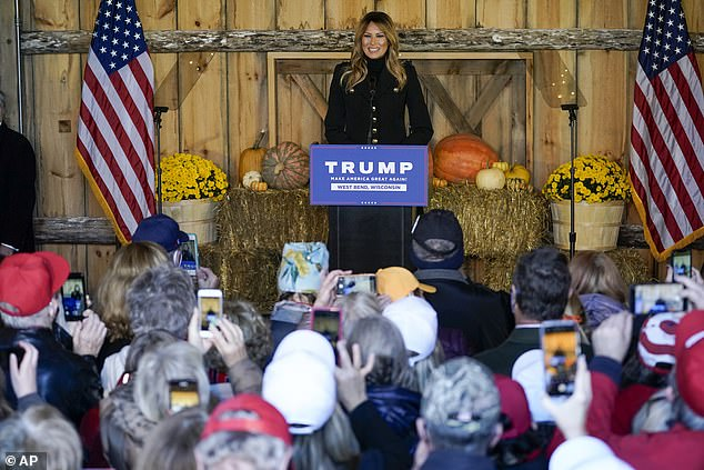 Campaigning: Melania has implored Americans to 'practice safe, responsible behaviors' during the upcoming holiday season while in West Bend, Wisconsin, on Saturday