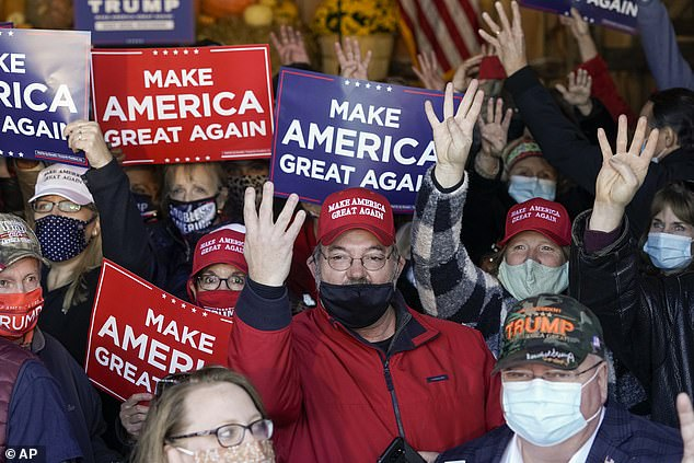 Covered: Almost all the attendees wore masks as they crowded into a semi-open barn to listen to the speech