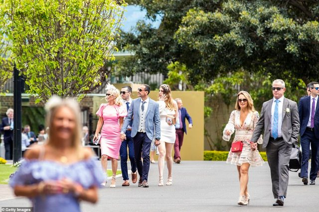 Spectators were banned from the race that stops the nation at Flemington Racecourse in Melbourne due to coronavirus restrictions but glamorous racegoers flocked to Bentley Cup Day at Royal Randwick Racecourse (pictured) in Sydney