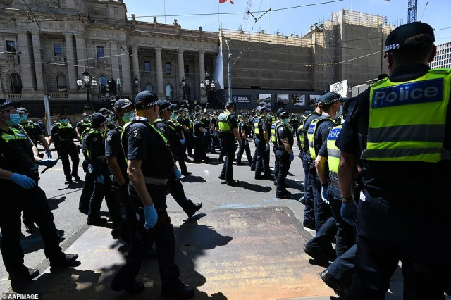 An Ambulance Victoria spokeswoman said at least one protester was assessed due to the pepper spray used by police