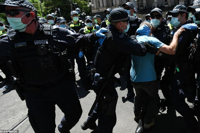 Another arrest was made after a protester was pinned to the ground by police officers (protest pictured above)