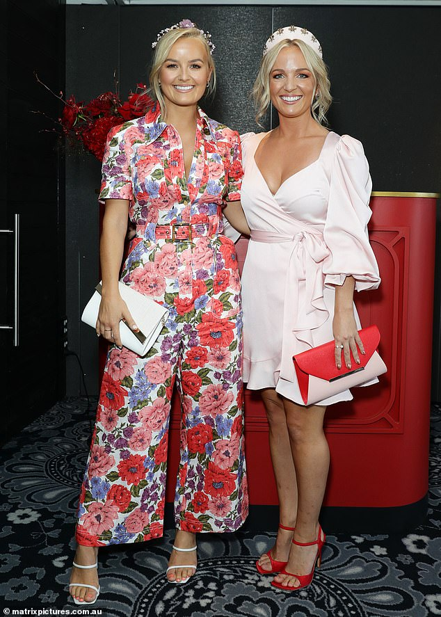 Well styled: Elly, 26, was right on-trend in a pink floral jumpsuit, which she paired with white strappy heels and a floral headband. Becky, 30, flaunted her trim pins in a a long sleeved mini dress
