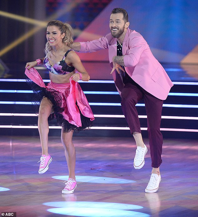 Nice rebound: Kaitlyn and Artem Chigvintsev, 38, rebounded from a weak showing last week to earn 25 points for their jive to Queen's Don't Stop Me Now, plus three points for their samba