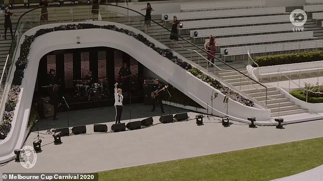 Empty venue: Jon and his band performed in the grandstand, an area usually reserved for punters, along with an eight-piece string section and a solo saxophonist