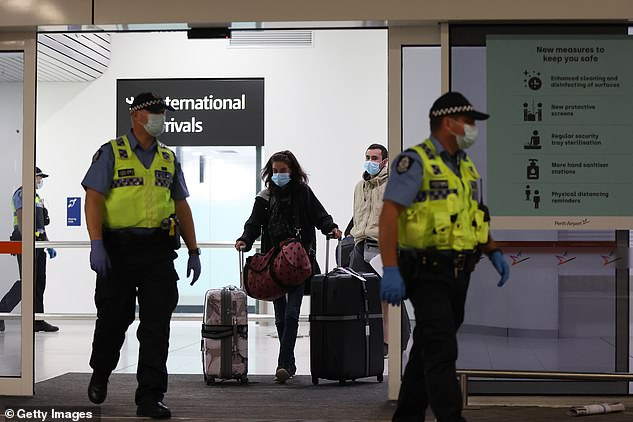 Western Australia banned travellers from any state on April 11 to stop the spread of coronavirus. Pictured: passengers arrive at Perth Airport from Sydney on October 19