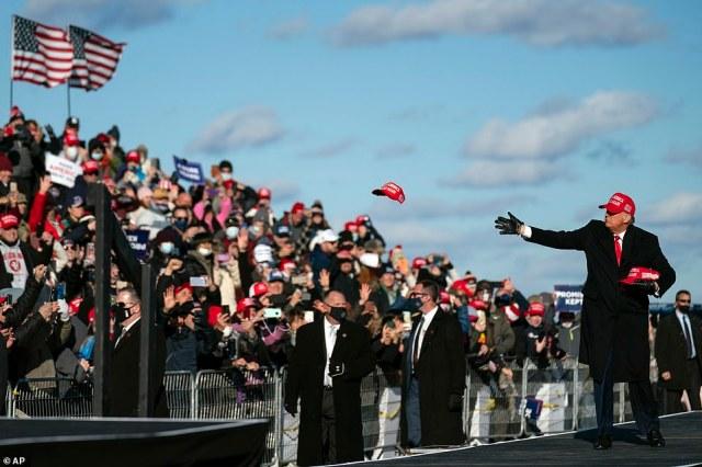 President Trump throws hats to supporters during a stop in Scranton, Biden's hometown