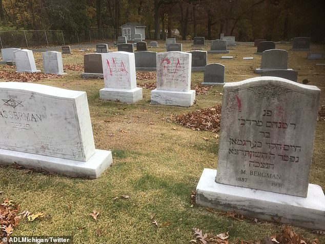 The messages spray-painted on the cemetery headstones included 'TRUMP' and 'MAGA'