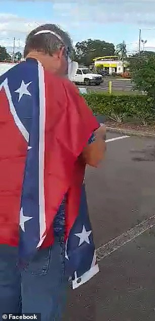 Scott Rexroat, 59, showed up at the rally wearing the confederate flag, a Trump mask, and carrying a sign with Swastikas