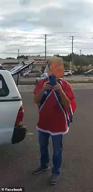A confederate flag and a Trump mask appeared to be just two of the things that were upsetting Trump supporters