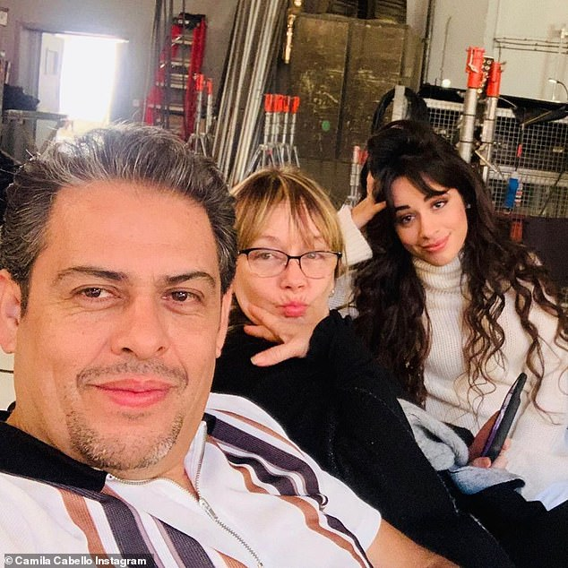 'These two legends': The 23-year-old pop star - who became an American citizen in 2008 -observes Día de Muertos because her father Alejandro is Mexican and her mother Sinuhe is Cuban (pictured January 9)