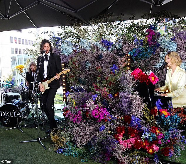Fancy: She was playing the song with her band at the network's studios, with the set decorated beautifully with flower walls