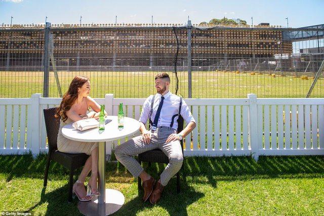 A couple are seen at a socially distanced table during Bentley Cup Day at Royal Randwick Racecourse