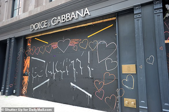 The above image shows a Dolce and Gabbana store in the SoHo section of Lower Manhattan after it was boarded up this weekend