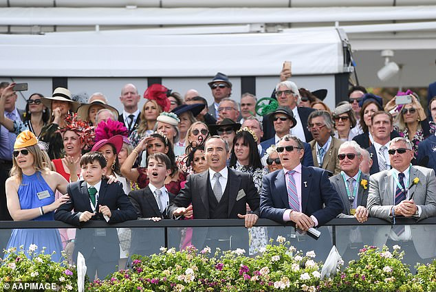 This year's event was a world away from typical celebrations with no crowds at Flemington. Pictured: Racegoers last year