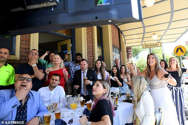Pictured: Sydneysiders gather atthe Harbour View Hotel to watch the race that stops the nation on Tuesday