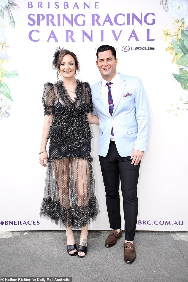 All is well: Brittney Weldon proved she was on friendly terms with Jamie Doran as the pair posed together on the red carpet at Brisbane's Melbourne Cup event on Tuesday