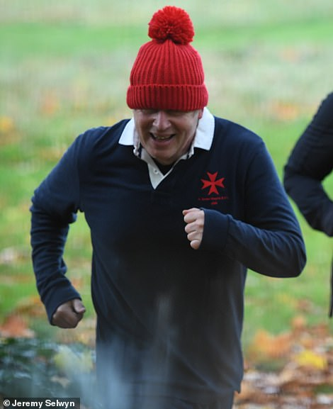 Prime Minister Boris Johnson out running in London this morning