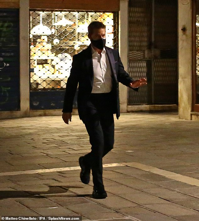 Heading in: Earlier on, Tom was seen walking to set through the empty streets of Venice