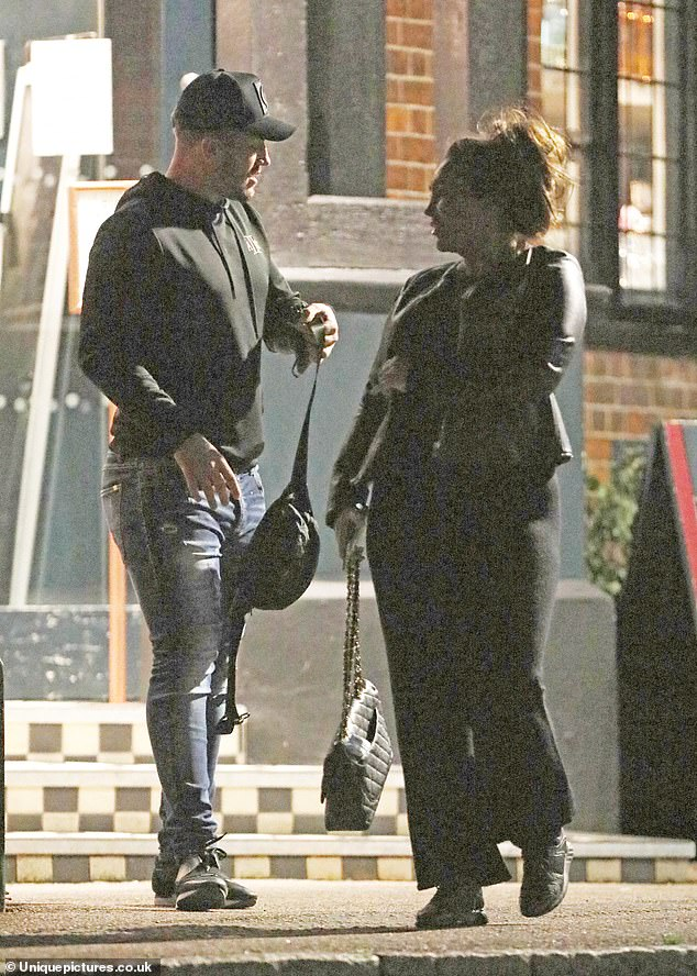 Chanello!Lauren kept things pared-back in her black look yet could not resist a designer touch as she toted a stylish quilted Chanel handbag