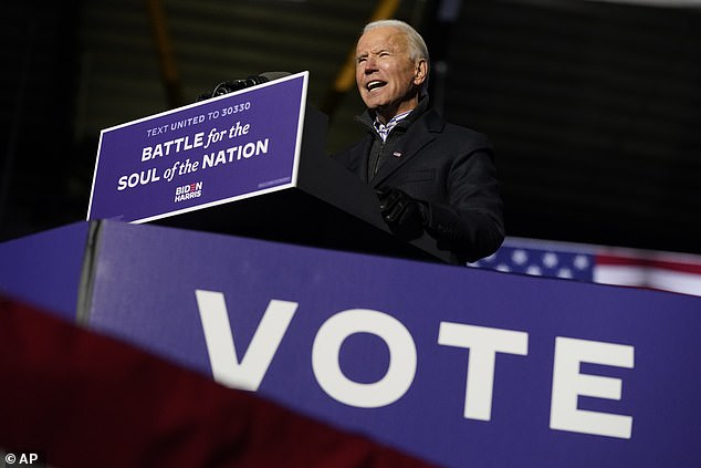 Biden told voters in Pennsylvania that the very fabric of the nation was at stake and offered his own election as the firmest rebuke possible to a president whom he said had spent 'four years dividing us at every turn'