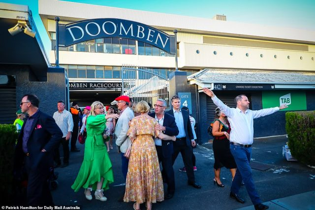 Revelers appeared overjoyed as they strolled into the event after months of Covid-19 restrictions prevented them from seeing friends and family