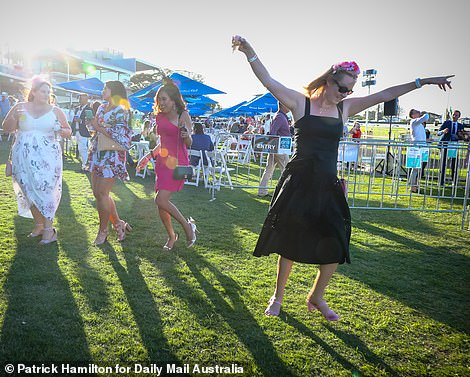 Feeling care free! Many party-goers appeared relaxed as they danced and drank at the race course in the early summer sunshine