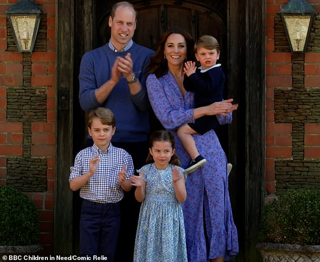 William and Kate with George, seven, Charlotte, five, and Louis, two, leading the nation in the 'Clap for Carers' in April