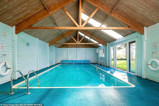 The 13th-century property's indoor heated swimming pool with a wooden ceiling and roof beams.Descendant Will Garton-Jones is the 40th recorded generation to inherit the historic home in North Wales