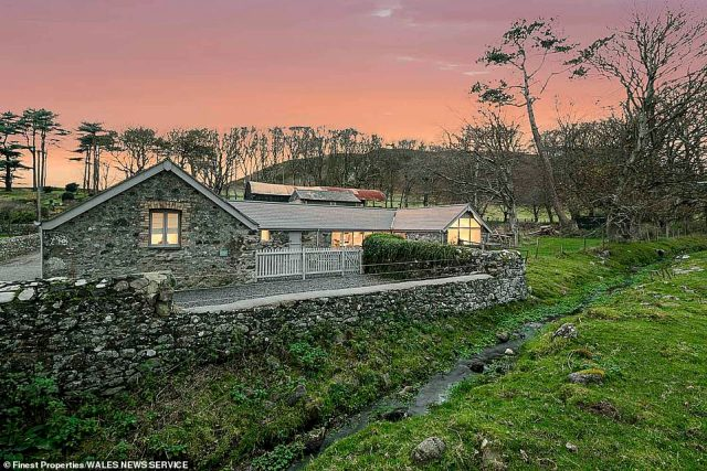 The exterior of the former cow shed, an outbuilding which was renovated into a luxury holiday cottage. Finest Properties described the setting as 'simply idyllic, nestledin a peaceful position with picturesque surroundings'