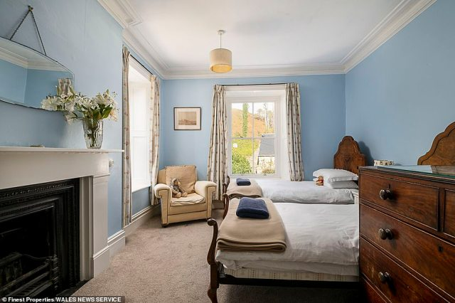 One of the bedrooms inside the main house, with twin beds and a fireplace. Estate agent Finest Properties said the grounds 'encompass a grand Grade II Listed country house and three fantastic self-catering holiday accommodation cottages'