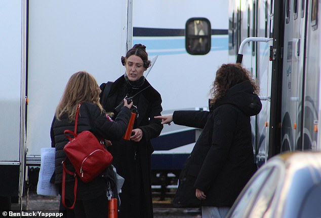 Careful: Suranne wore the shield whenever she wasn't shooting, as an insider said: 'As soon as she finished the scene she reached for her visor. She is clearly taking no chances'
