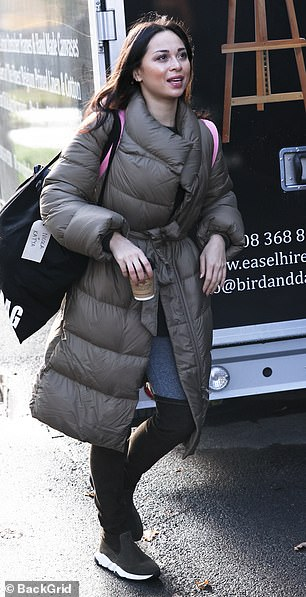 Out and about; Brunette beauty Katya fuelled up on coffee on her way to training