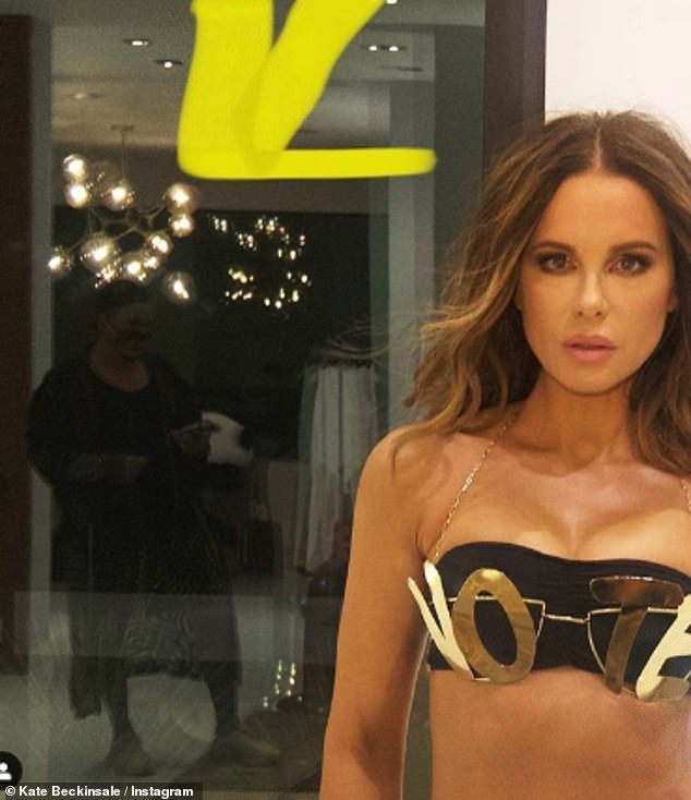 VOTE! British-born Kate Beckinsale shared a behind-the-scenes snap for her presidential themed bikini photoshoot on Instagram on Tuesday