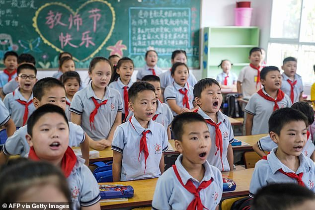 Beijing's new patriotism education will not include the intense scrutiny over its response to the virus, with the US and Australia leading accusations against the country that it covered up the origins and severity of the crisis. School students attend a class in Wuhan on September 1