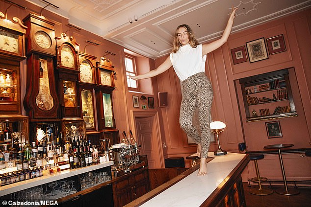 Making the counter her runway: Emma strutted her stuff across a pub table