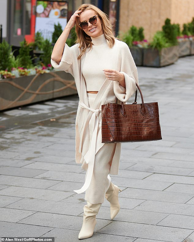 Cosy: The radio presenter, 49, sported a sleeveless polo neck and matching wide-legged trousers, while finishing the look with a cosy cardigan tied around her waist