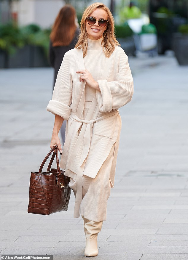 Glam gal: Amanda Holden looked as chic as ever on Tuesday morning, as she arrived at work in central London wearing a stylish knitted cream ensemble