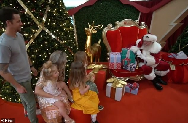 Children will not be allowed to sit on Santa's lap, rather they will be required to be 1.5m away from Father Christmas