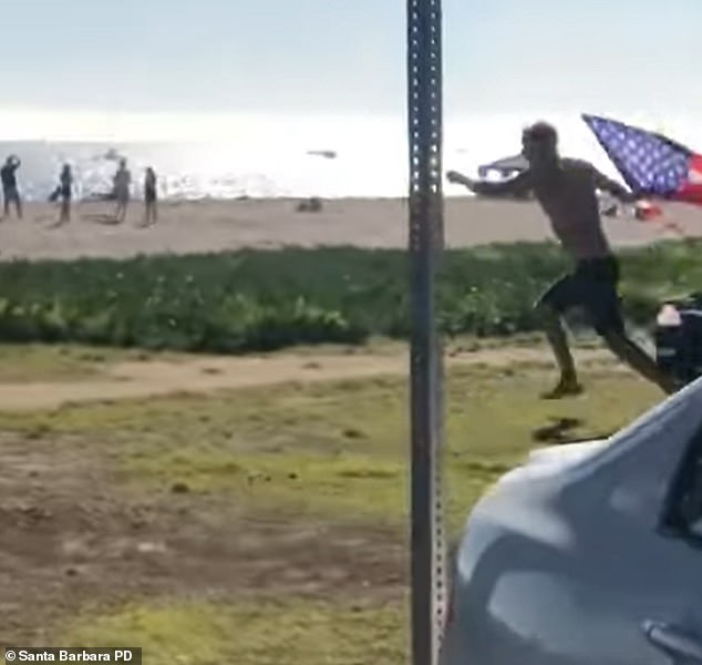 The male suspect sprints off down the beach away from the cops