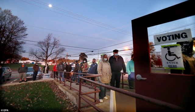 EDINGBURG, OHIO: Voters wait in line before dawn at a polling location at the Edinburg Town Hall in Edinburg