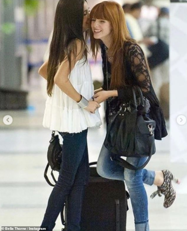 Taking it back: Another throwback image saw them having a giggle together as Pia whispered something in Bella's ear