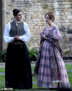 Role: Getting into character, Suranne donned a grey waistcoat over a white shirt and a long black skirt to transform into her character Anne Lister