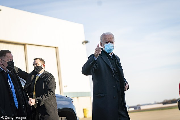 He gave a thumbs up to reporters as he boarded a flight in Delaware to head to the Keystone State