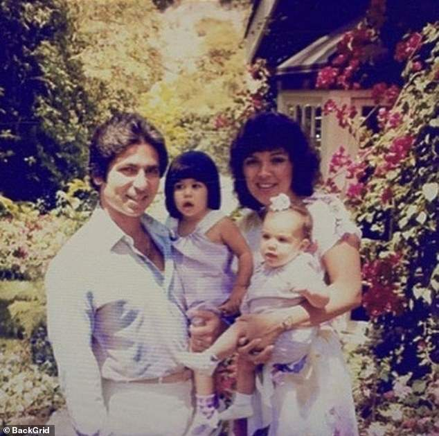 The family bond: Kim being held by Kris with Kourtney next to her and Kim's late dad Robert