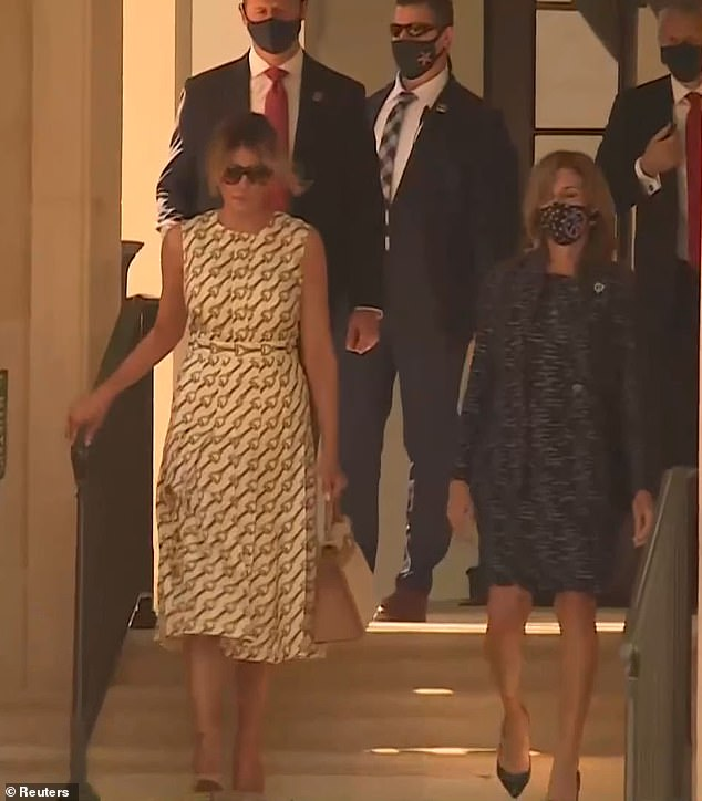 Team: Melania was flanked by several Secret Service agents as she exited the polling station, having spent just a matter of minutes inside casting her vote