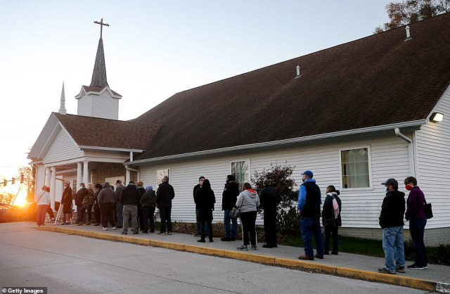 DES MOINES, IOWA: People stand in line to vote as the sun rises at Bloomfield United Methodist Church