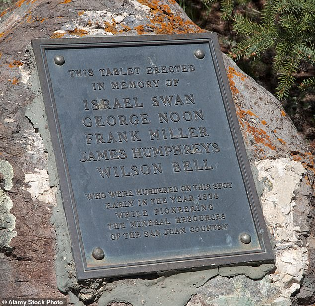 A memorial plaque installed for the five men in Lake City is pictured