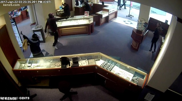 The couple were having their wedding rings cleaned when a pair of armed robbers ran inside the store