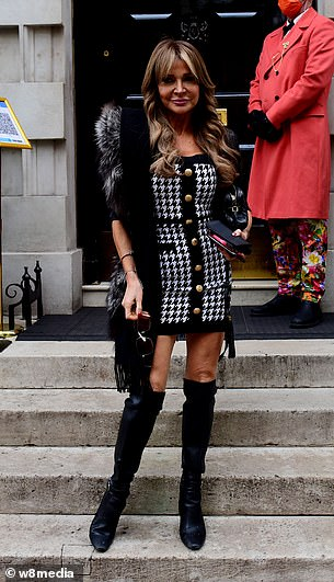 Pose: Styling her brunette tresses into voluminous waves, Lizzie accessorised with a black handbag